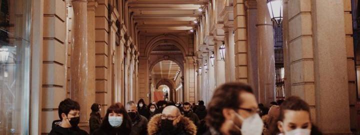 People wearing face masks walking in a European city.